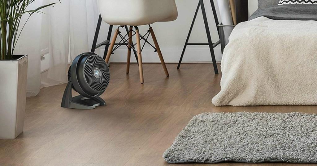 vornado fan on wooden floor of bedroom