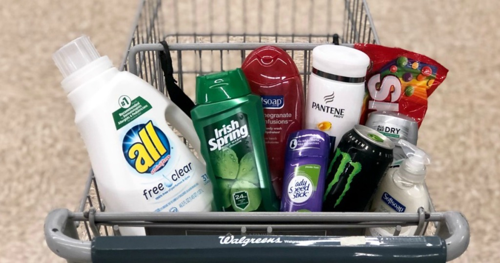 all laundry detergent, irish spring and soft soap body wash, pantene shampoo, speed stick deodorant, monster energy drink and skittles candy in a shopping cart at walgreens