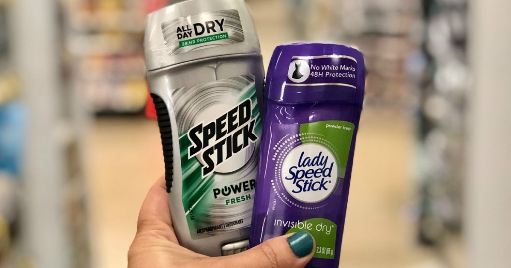 hand holding speed stick and lady speed stick deodorant at walgreens