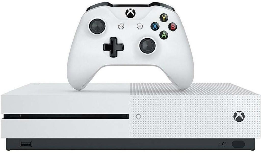 white gaming console with white controller on top