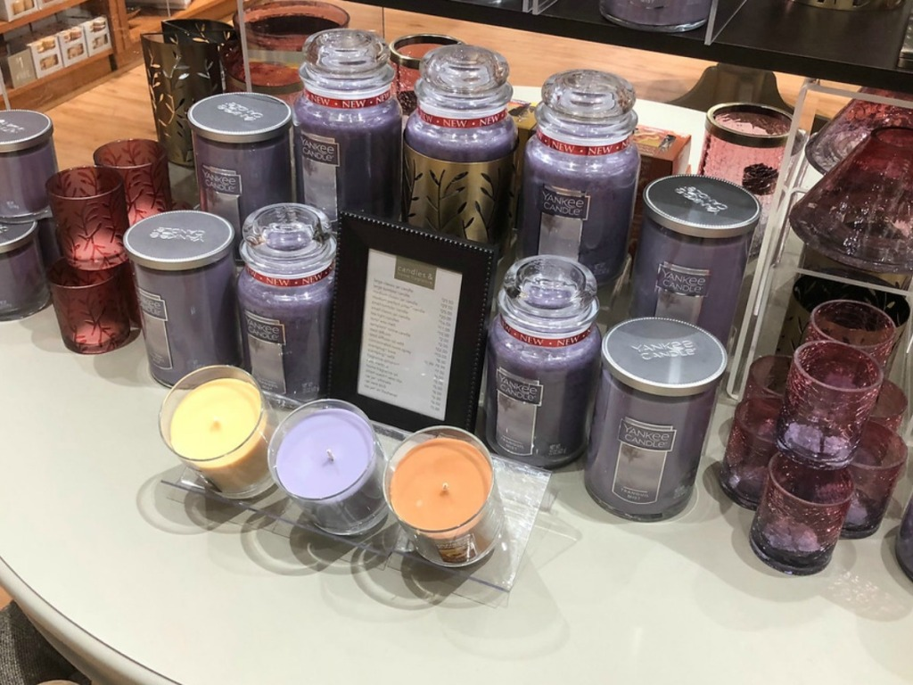 a bunch of candles sitting on table in store