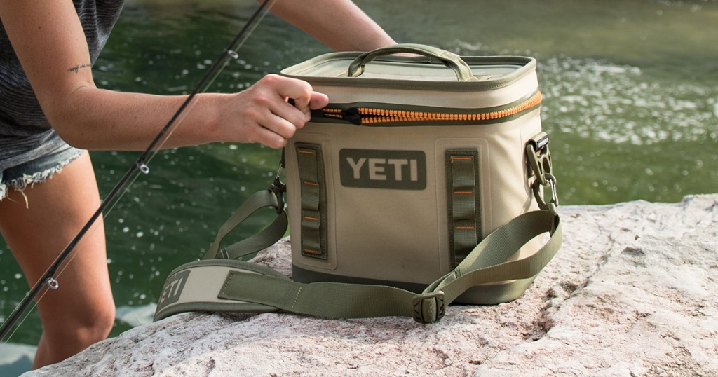 yeti hopper 8 soft side cooler near river