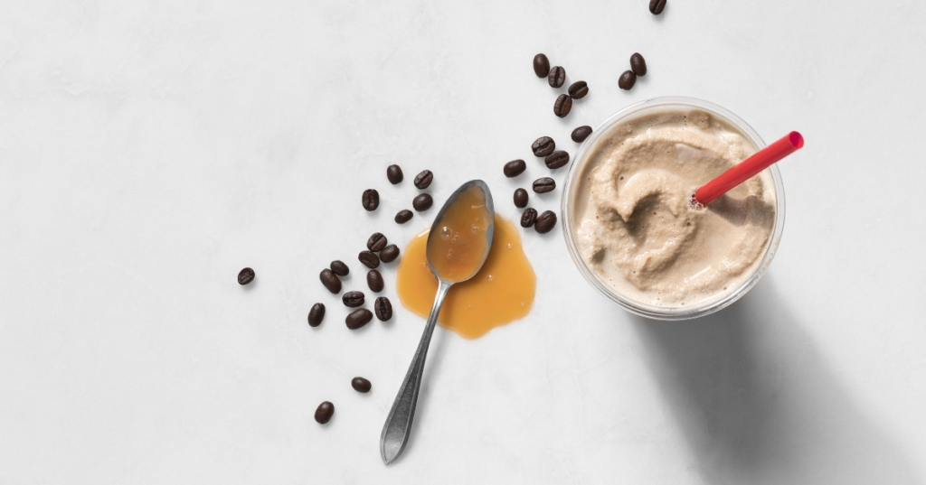 spoon with caramel, coffee beans and Chick-fil-A frosted coffee