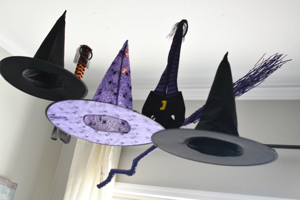 witch hats hanging from ceiling as decor