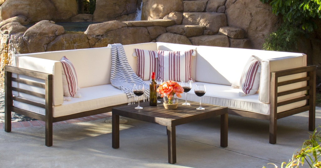 acacia wood section sofa on patio