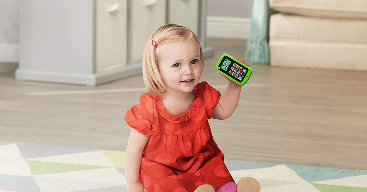 gilr holding Leapfrog Chat and Count Phone
