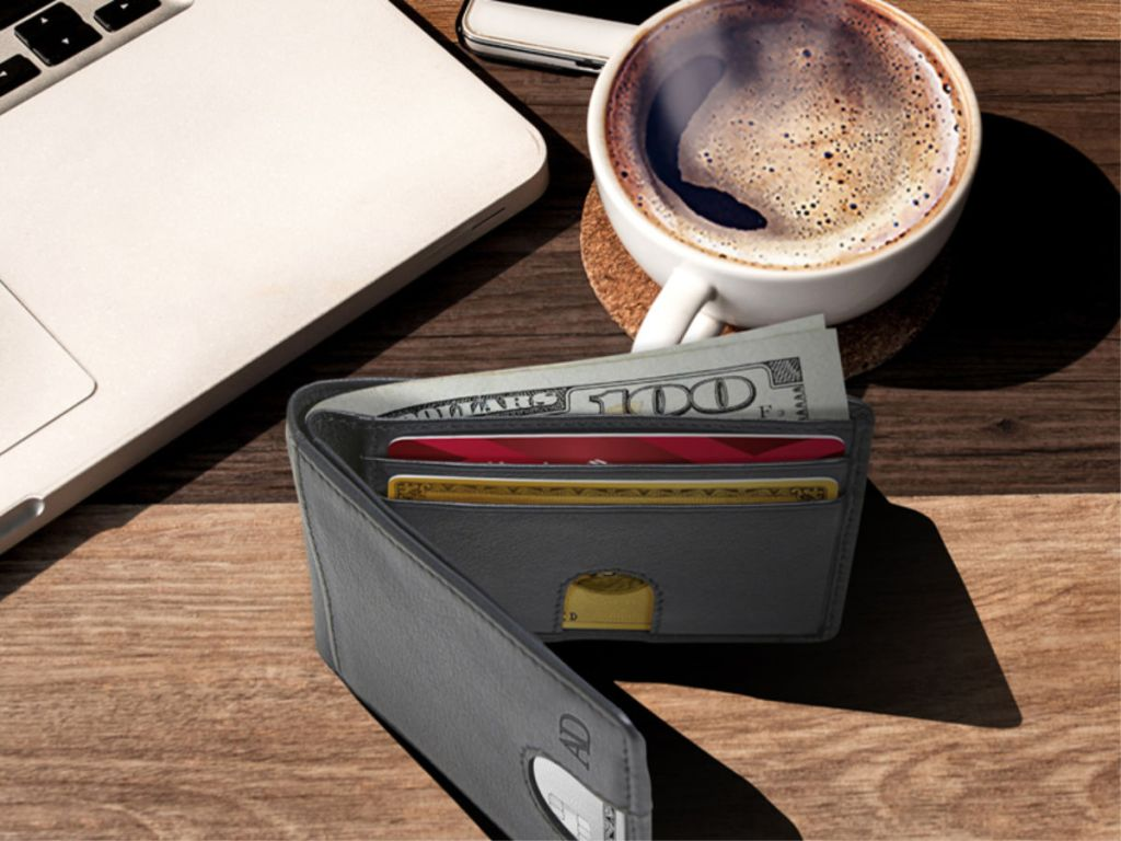 black Access Denied Bifold Wallet with cup of coffee and macbook