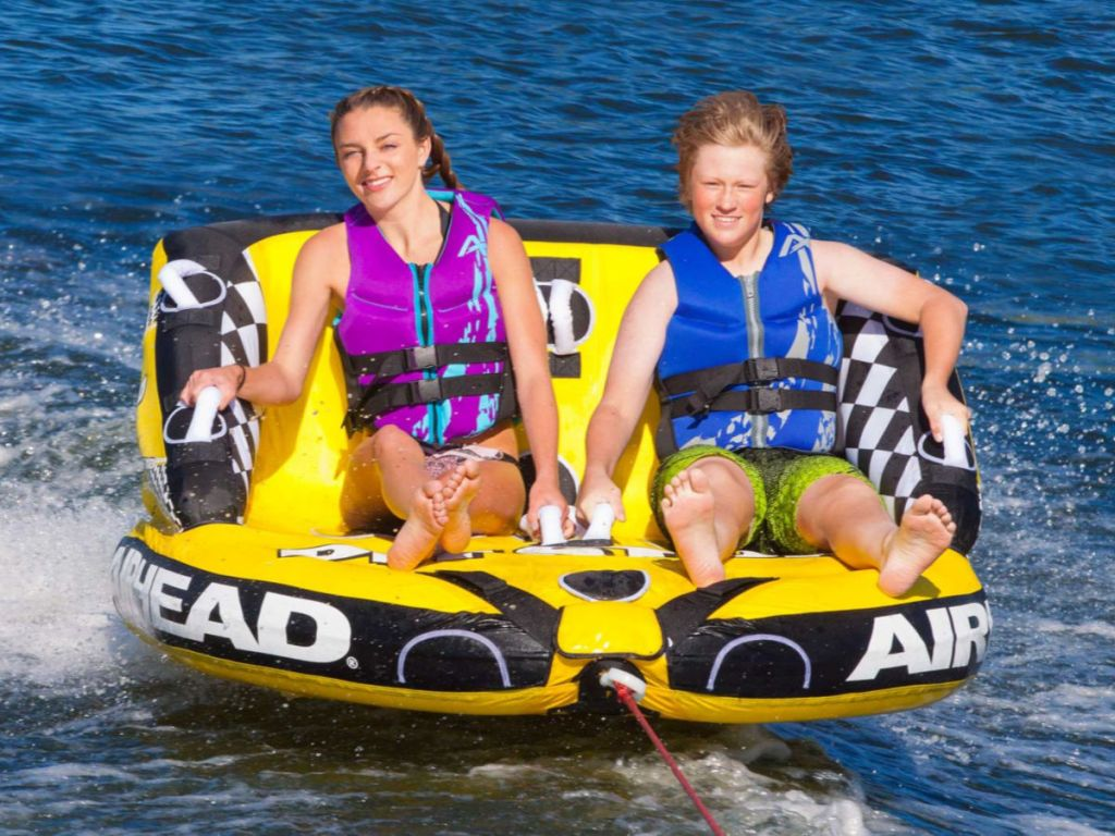 2 people on Airhead Pit Stop 2-Person Towable Tube on the water