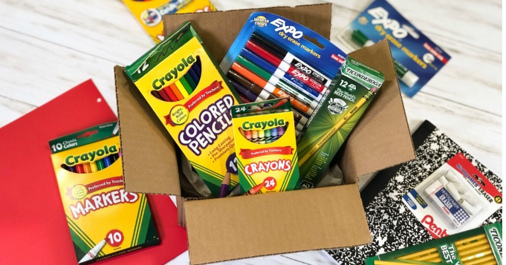 school supplies in cardboard box