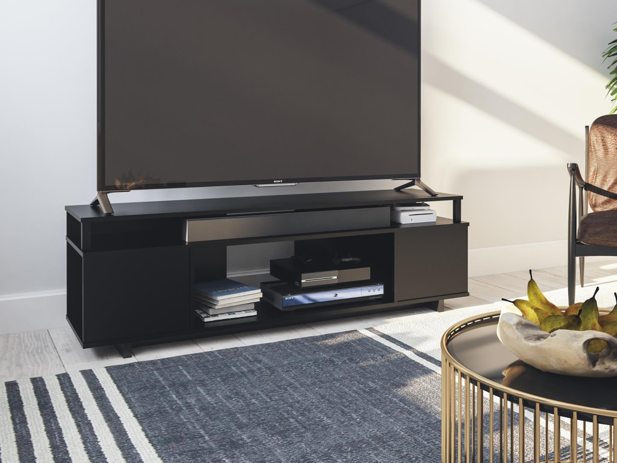 black television stand with a flat screen TV on top