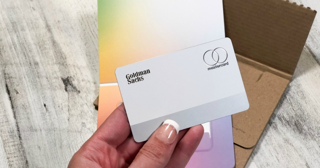 Woman holding Apple Card