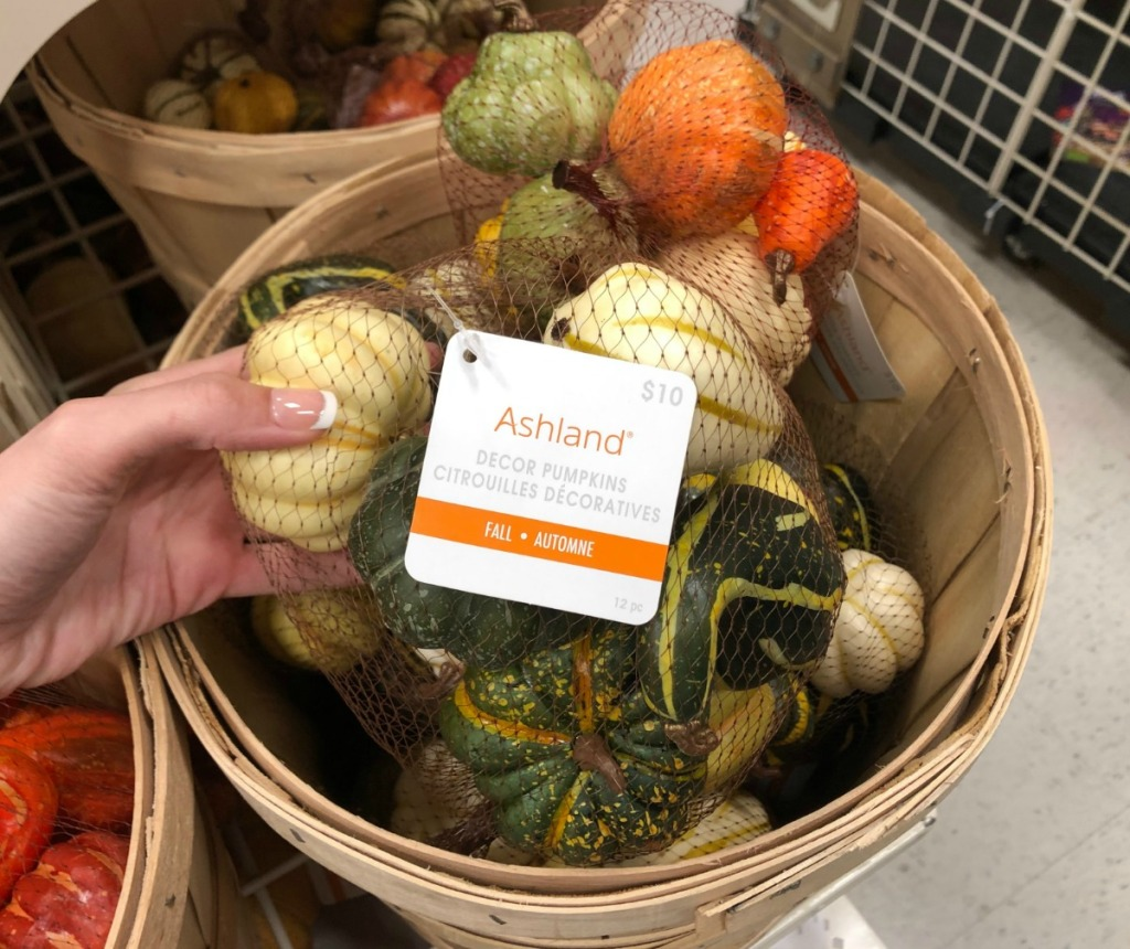 Small pumpkin decor in bag in basket in store at Michael's