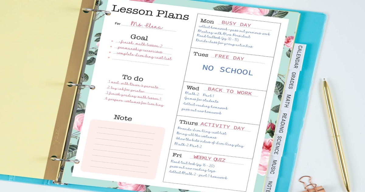 Clear dividers in a blue three ring noteboook with a lesson plan on top.