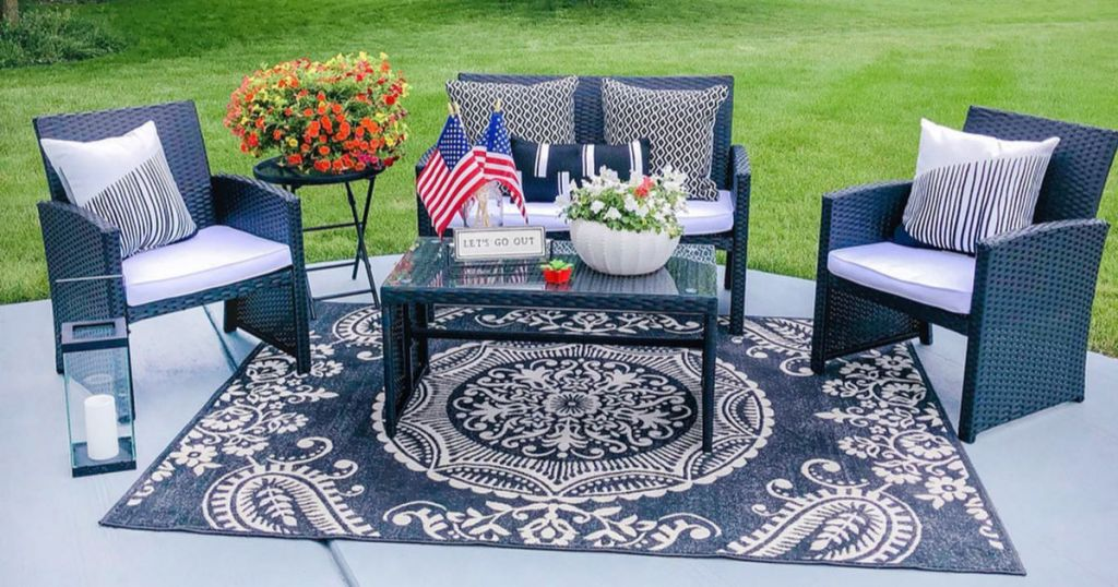 BCP 4-Piece Wicker Patio Set outside with decor and rug