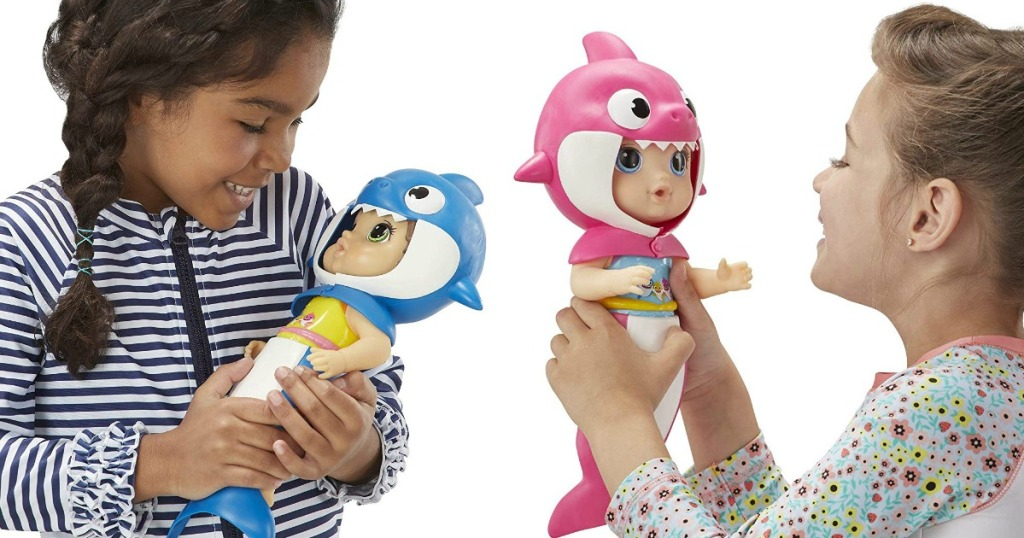 girls holding Baby Alive Baby Shark dolls