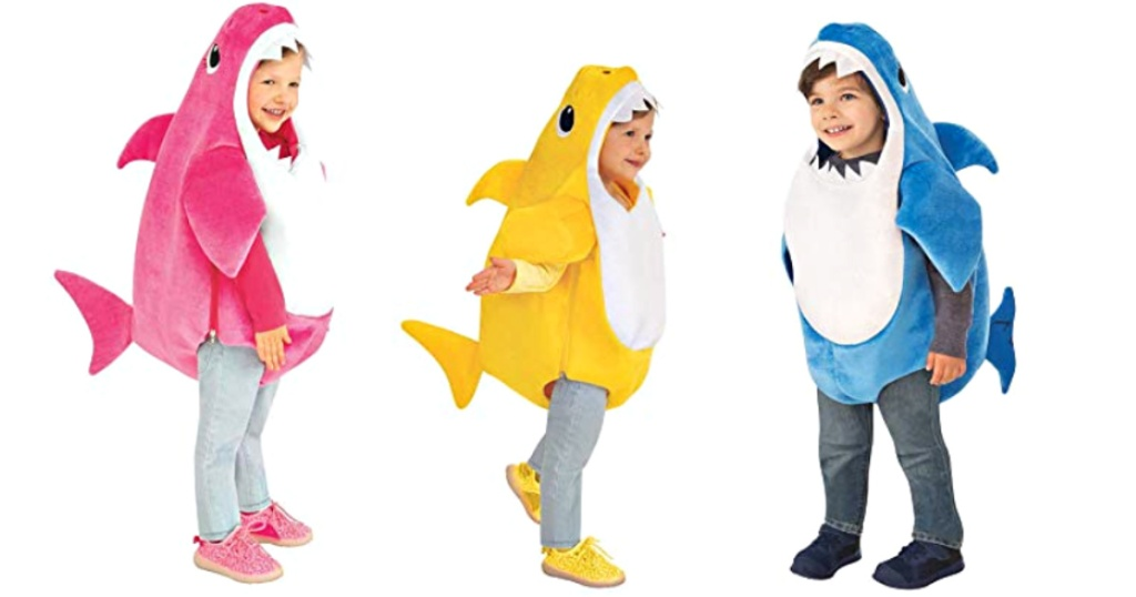 3 kids wearing baby shark costumes