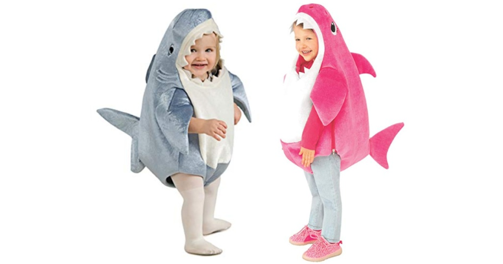 2 kids wearing baby shark costumes