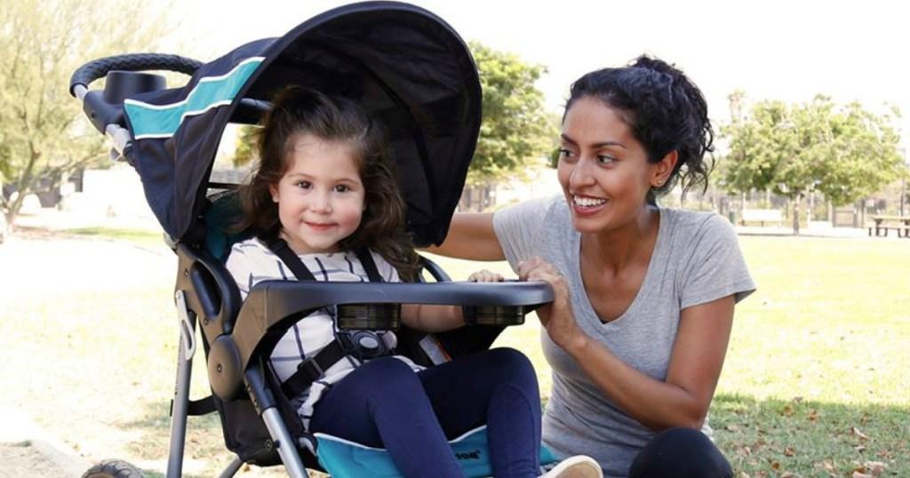 kid riding in stroller