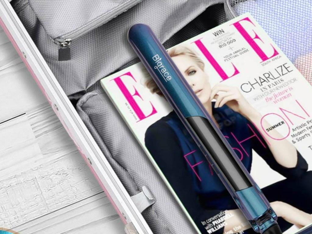 bigrace hair iron on elle magazine in suitcase
