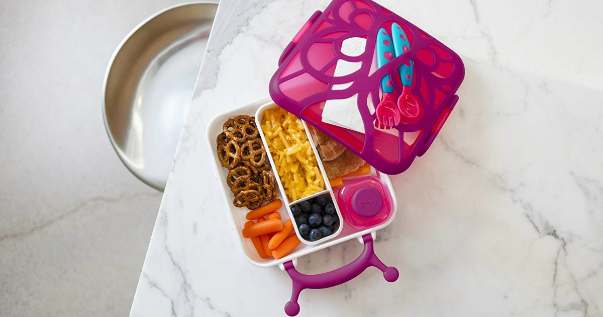 pink snail bento box with macaroni & cheese and veggies inside
