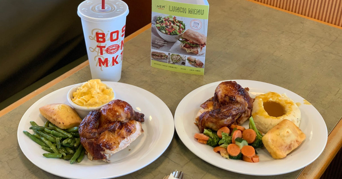 two boston market meals with drink on table
