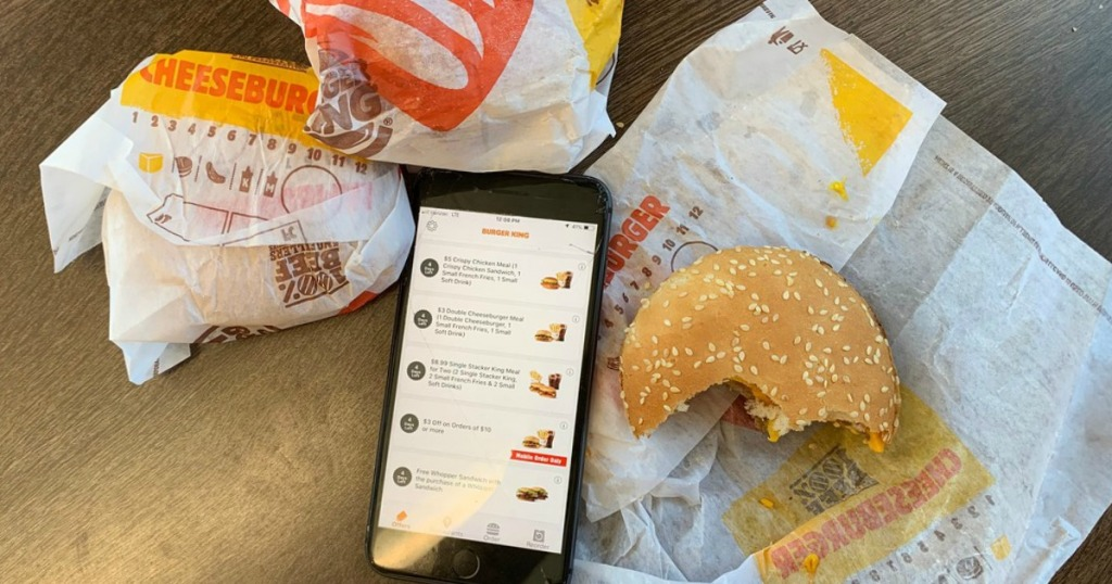 Burger King Cheeseburgers next to phone with BK app