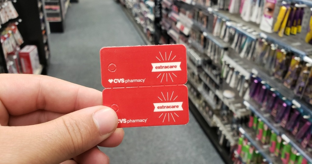 man holding CVS ExtraCare Cards