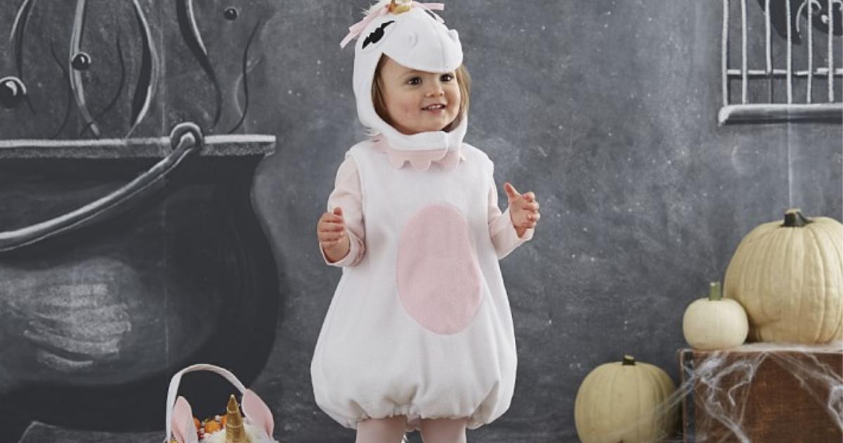 girl wearing carters unicorn costume