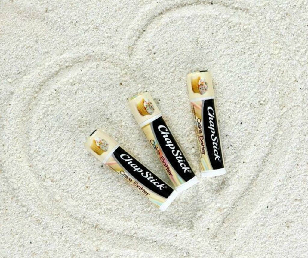 ChapStick brand lip balm in sand with heart drawn