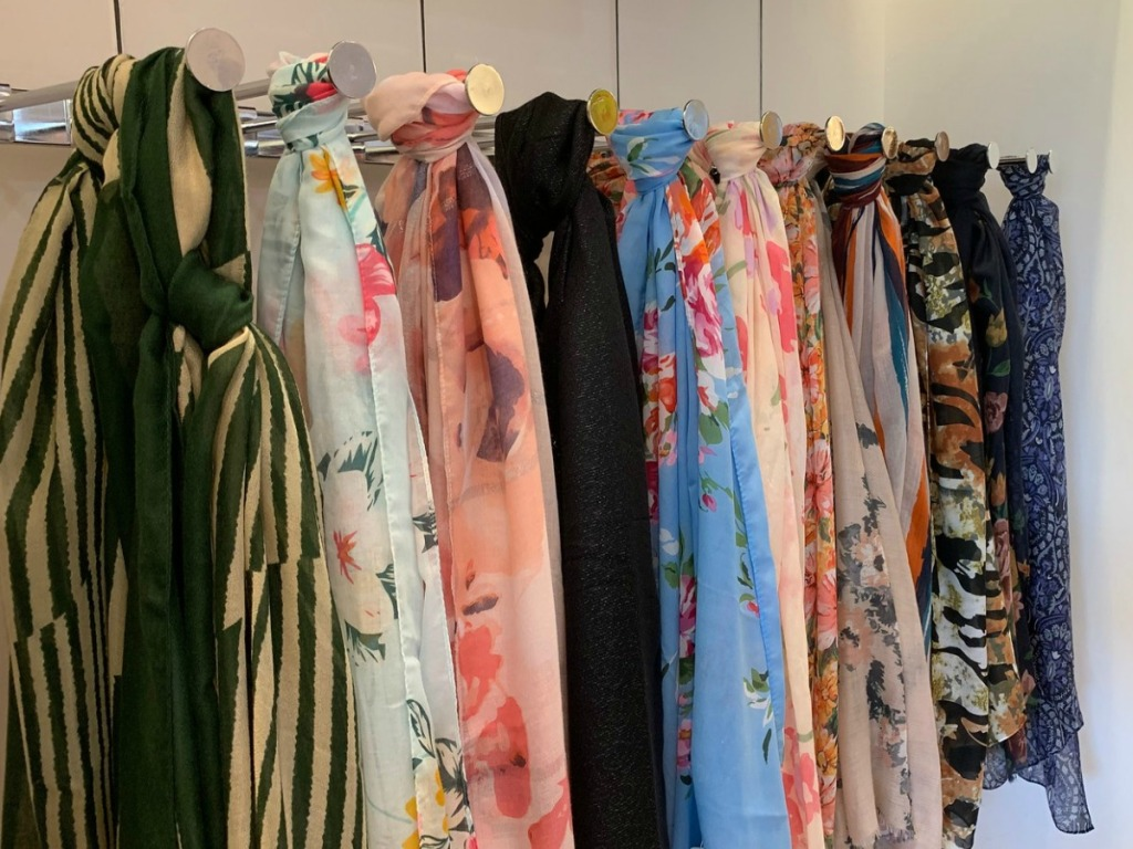 Charming Charlie Scarves hanging in store