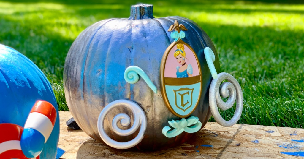 Pumpkin painted blue and decorated with Cinderella accessories