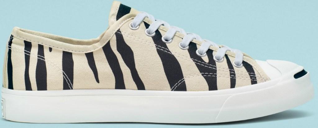 Zebra striped Low top Converse brand shoes