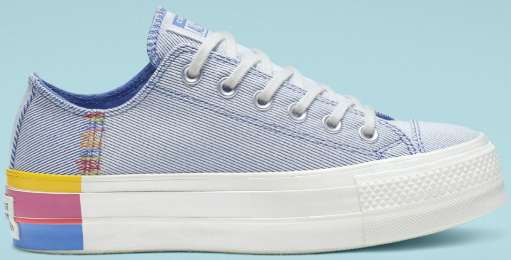 Converse brand light blue shoes with rainbow platform bottom