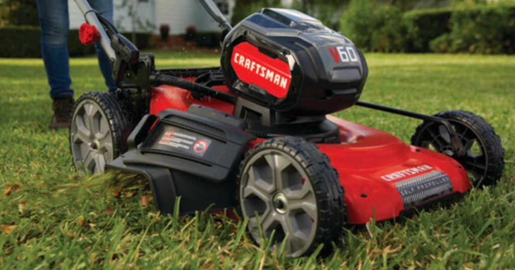 man puushing Craftsman 60-Volt Max Lithium Ion Self-Propelled Cordless Electric Lawn Mower in yard