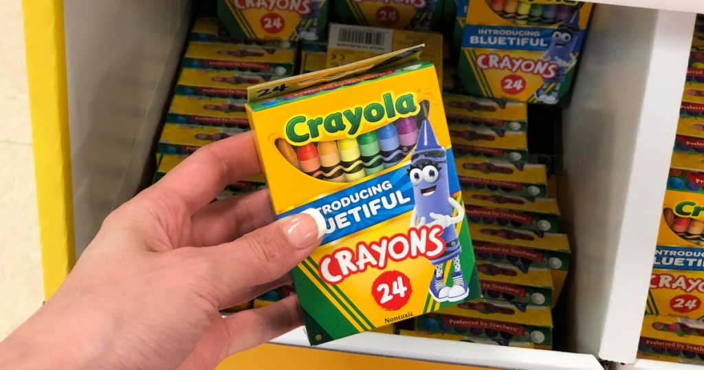 hand holding Crayola Crayons 24 count