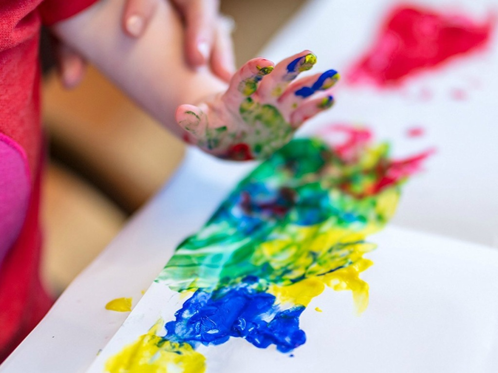 kid paining with Crayola finger paints