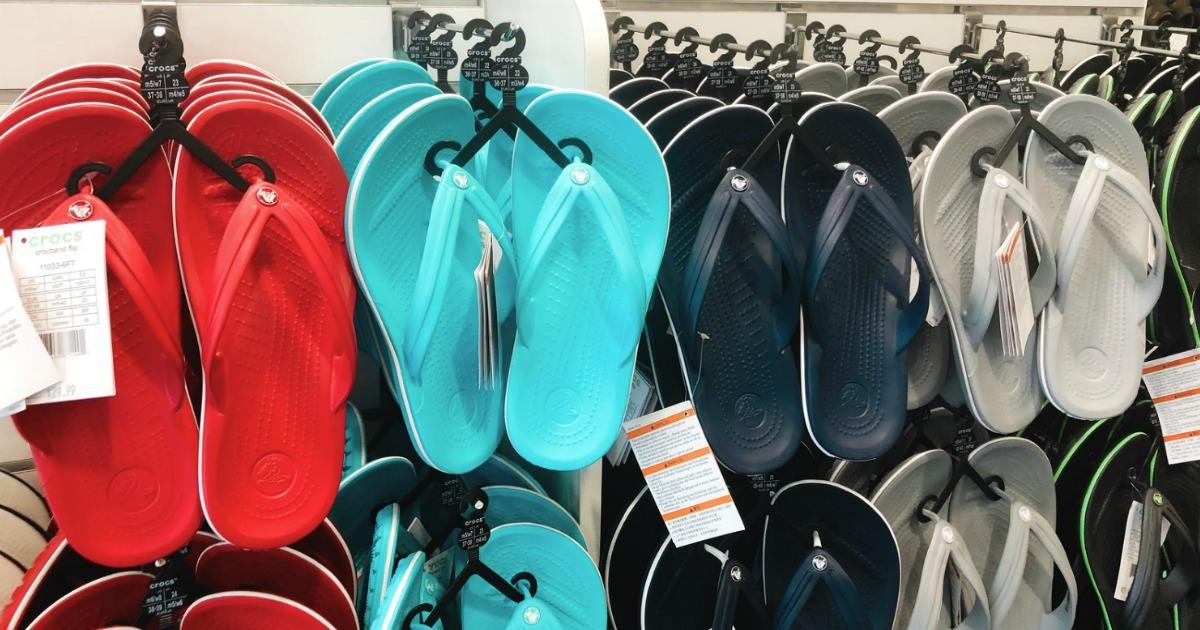 Styles of Crocs flip flops on store rack