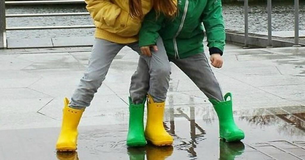 kids playing in the rain wearing Crocs Handle It Rain Boots