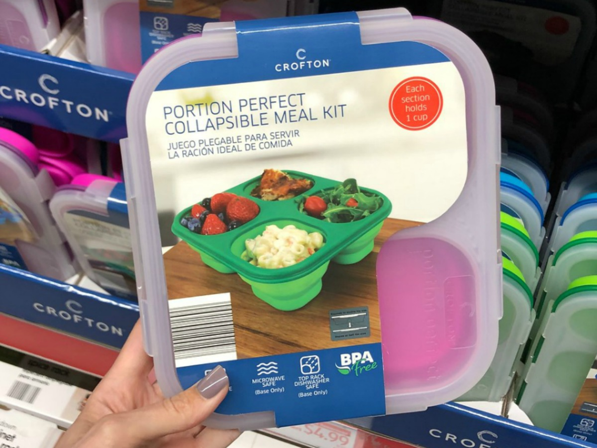 hand holding plastic lunch kit by store display