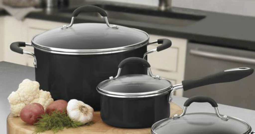 Cuisinart brand pan set with lids on island counter top