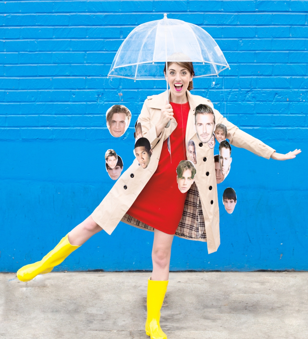 woman with umbrella and rainboots with male celebrity head print outs