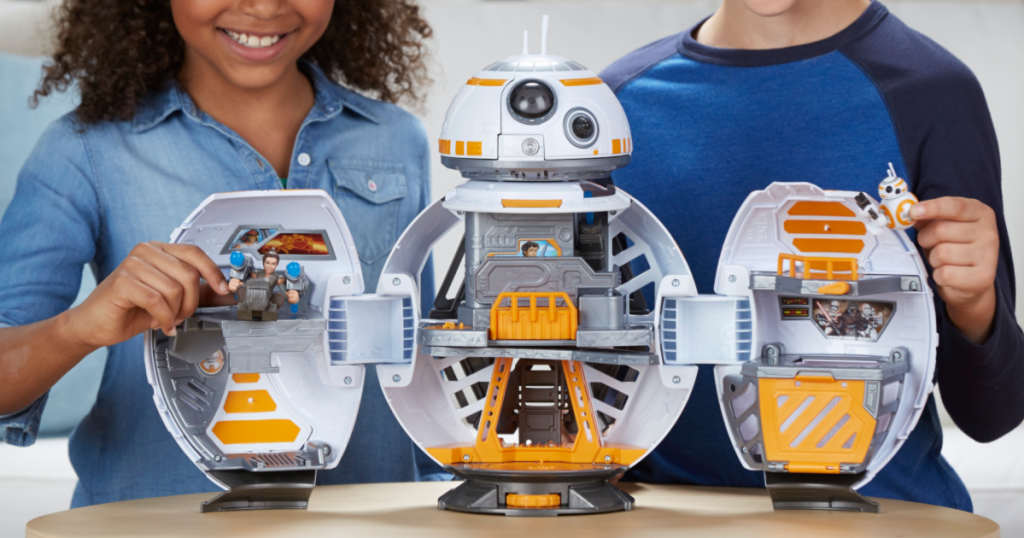 Disney Star Wars Galactic Heroes BB-8 Adventure Base opened up with two kids in background
