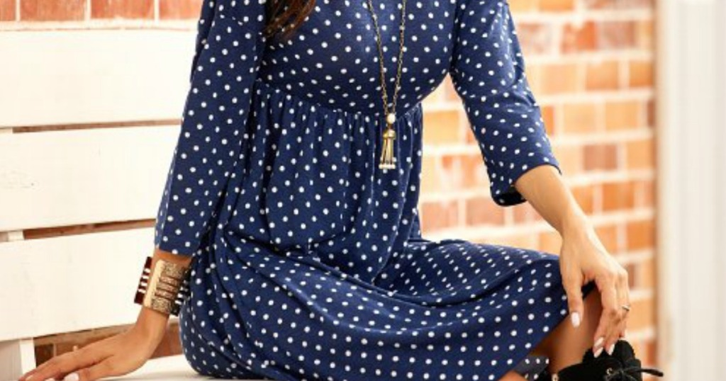 lady sitting in a blue and white polka dot fall dress