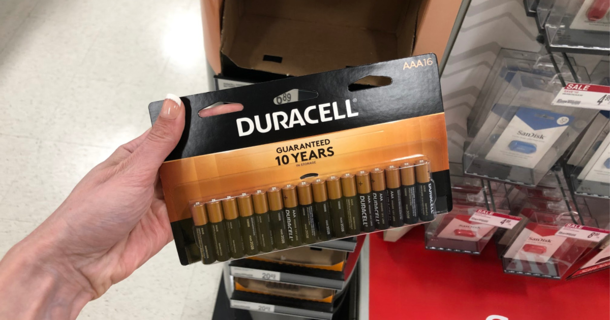 hand holding duracell aaa batteries