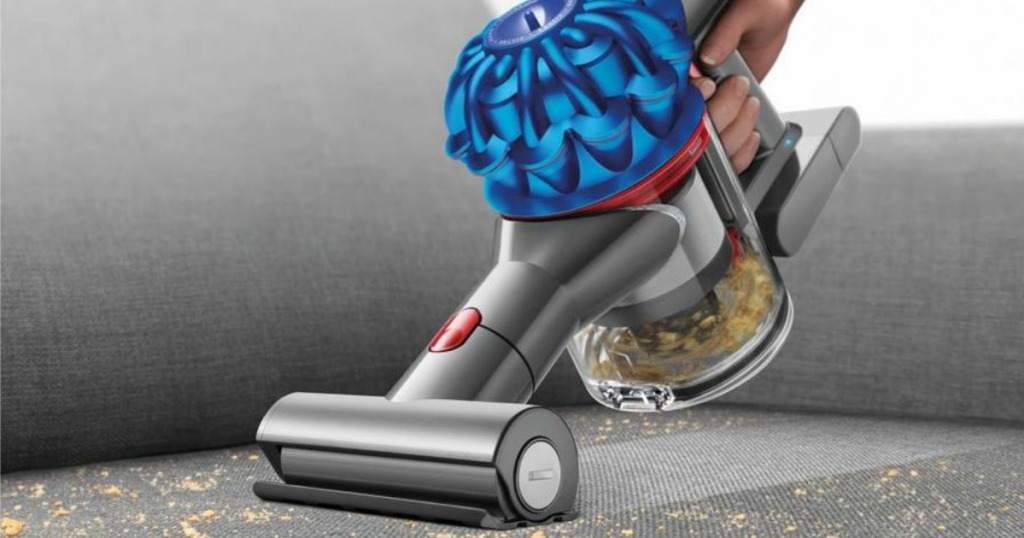 Dyson V7 Trigger Handheld Vacuum vacuuming couch