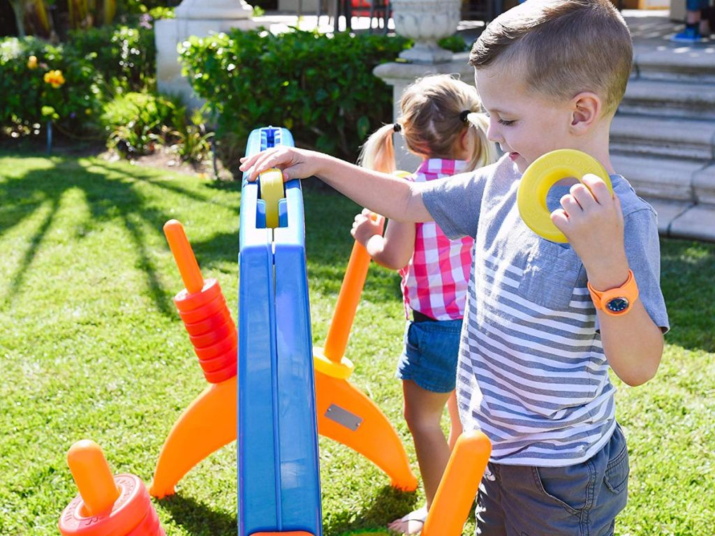 kids playing with ECR4Kids Junior 4-to-Score Giant Game Set in grass