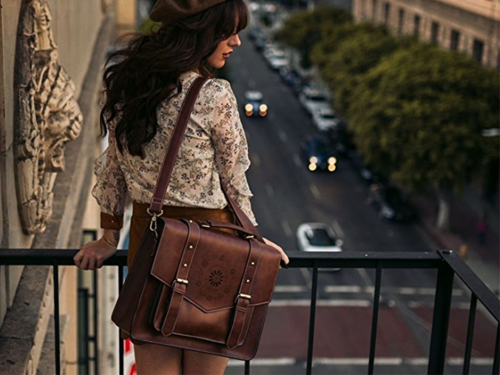 woman wearing brown Ecocusi Leather Briefcase Messenger Laptop Bag looking over balcony