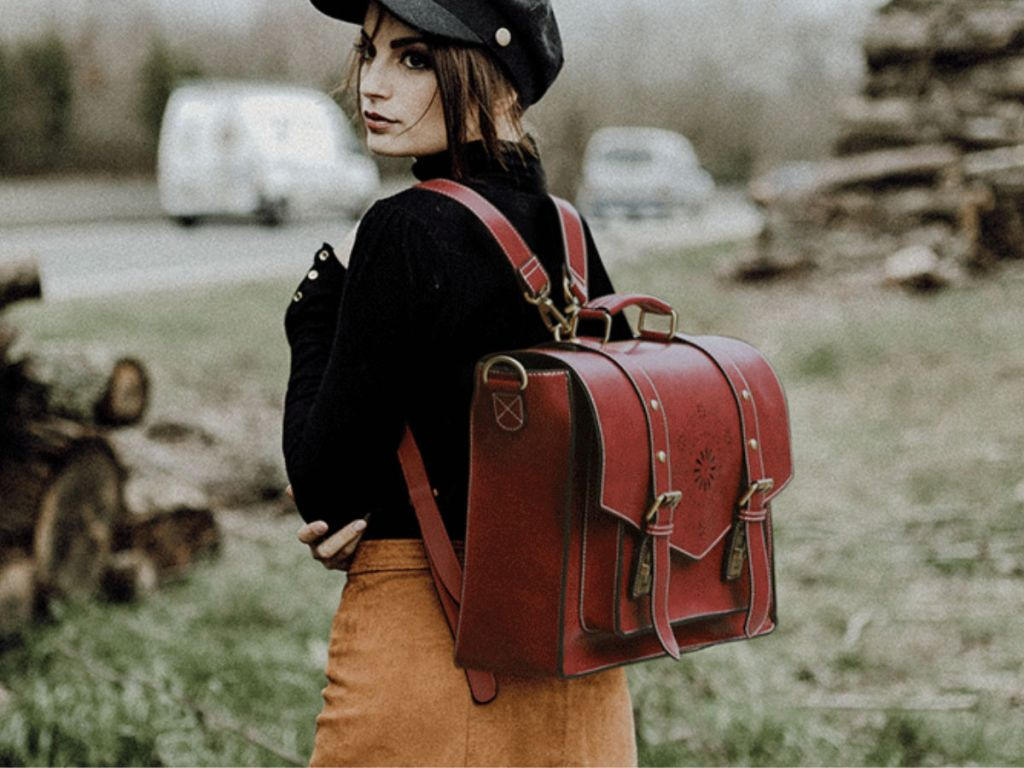 Woman wearing Ecocusi Vegan Leather Backpack Style Messenger Laptop Bag in field