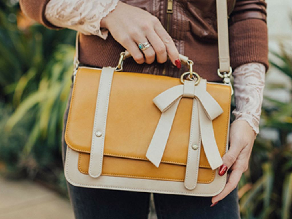 woman wearing yellow and cream colored Ecocusi Vintage Vegan Leather Crossbody Satchel Bag