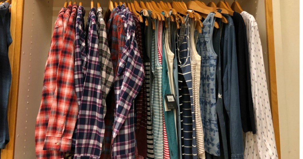Eddie Bauer Clearance rack with women's tank tops and flannels